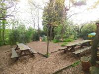 Picnic tables in our woodland area.